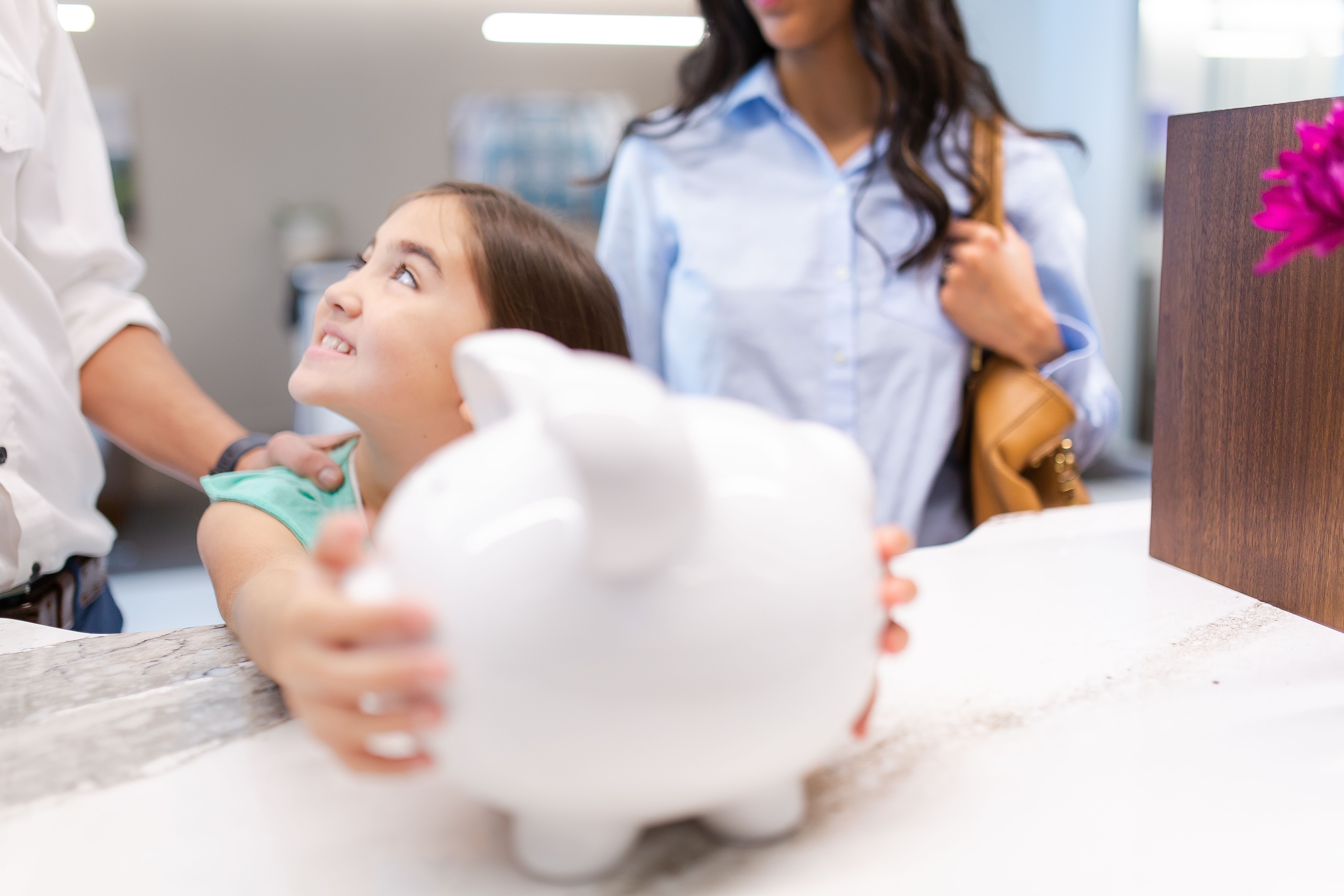 Young girl opening a Milestone Savings account at SouthEast Bank