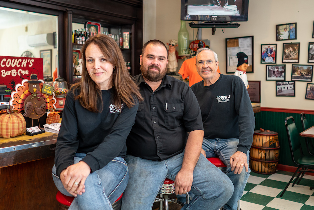 Couch's BBQ owners smile at camera
