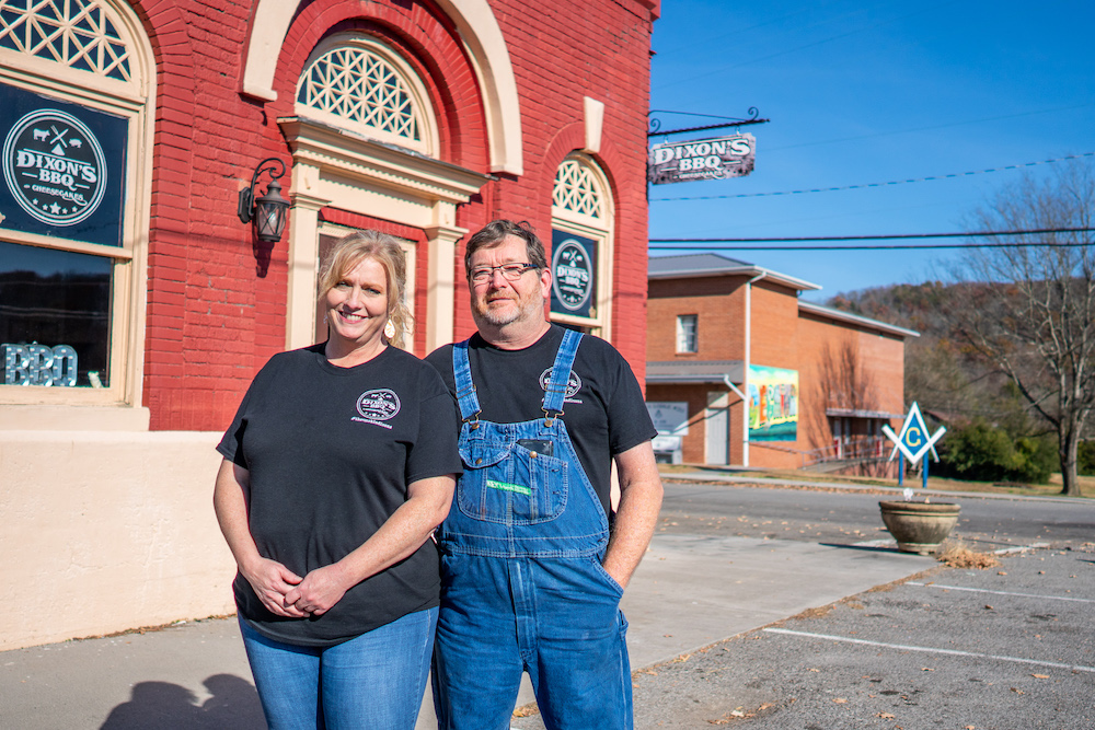 Dixon's BBQ owners smile at camera
