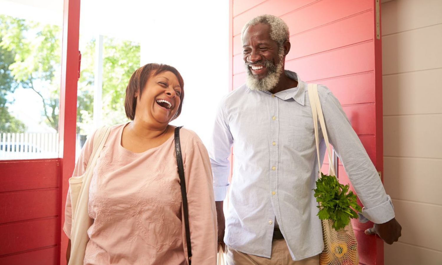 Man and woman returning home after purchasing groceries with Accelerate